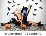 two cheerful young women in... | Shutterstock . vector #719208640