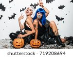 two cheerful young women in... | Shutterstock . vector #719208694