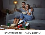 young couple watching tv in... | Shutterstock . vector #719218840