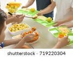 volunteers serving food for... | Shutterstock . vector #719220304