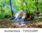 a bonfire and a tourist tent in ... | Shutterstock . vector #719221009