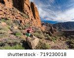 trail running girl in mountains ... | Shutterstock . vector #719230018