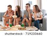 friends watching tv at home | Shutterstock . vector #719233660