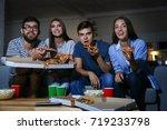 friends watching tv in evening... | Shutterstock . vector #719233798