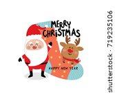 santa claus  reindeer and sock... | Shutterstock .eps vector #719235106