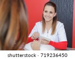 woman filing customers nails | Shutterstock . vector #719236450