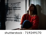 depressed woman sitting on the... | Shutterstock . vector #719249170