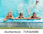 children rest in the pool in... | Shutterstock . vector #719264080