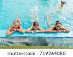 children rest in the pool in... | Shutterstock . vector #719264080