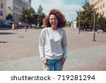 curly haired girl with freckles ... | Shutterstock . vector #719281294