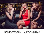 beautiful women are sitting on... | Shutterstock . vector #719281360