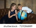 a boy and a girl in the... | Shutterstock . vector #719286889