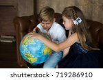 a boy and a girl in the... | Shutterstock . vector #719286910