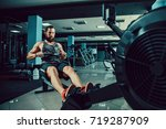 bearded muscular fit man ssing... | Shutterstock . vector #719287909