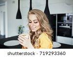 pretty girl is drinking coffee...   Shutterstock . vector #719293360