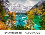first snow on braies lake.... | Shutterstock . vector #719299729