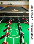 Small photo of Closeup of soccer table with pool table
