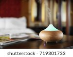 aroma oil diffuser on wooden... | Shutterstock . vector #719301733