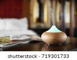 aroma oil diffuser on wooden... | Shutterstock . vector #719301733