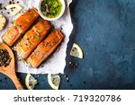 Stock photo delicious fried salmon fillet seasonings on blue rustic concrete background cooked salmon steak 719320786