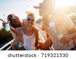 group of young happy friends... | Shutterstock . vector #719321530