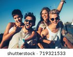 group of young happy friends... | Shutterstock . vector #719321533