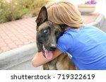 female volunteer with homeless... | Shutterstock . vector #719322619