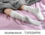 Young Woman In Socks Lying On...