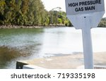 Small photo of warning sign for High-pressure gas main near the river.