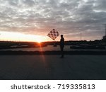 competition. man with checkered ... | Shutterstock . vector #719335813