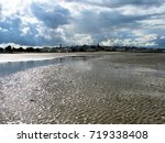 tide out at ryde beach on the... | Shutterstock . vector #719338408