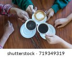 closeup of hands with coffee... | Shutterstock . vector #719349319