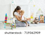 mother with child playing... | Shutterstock . vector #719362909