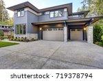 new construction home exterior... | Shutterstock . vector #719378794