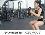 fitness woman in training...   Shutterstock . vector #719379778