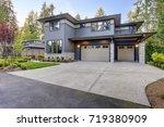 new construction home exterior... | Shutterstock . vector #719380909