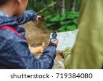 daughter and mother hiking in... | Shutterstock . vector #719384080