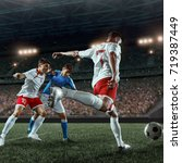 soccer players fighting for the ... | Shutterstock . vector #719387449