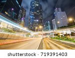 traffic in hong kong at night   Shutterstock . vector #719391403