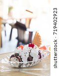 ice cream in glass bowl in cafe | Shutterstock . vector #719402923