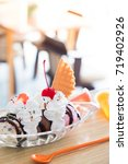 ice cream in glass bowl in cafe | Shutterstock . vector #719402926