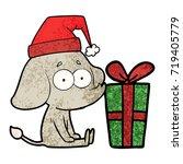 cartoon unsure elephant sat on... | Shutterstock .eps vector #719405779