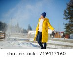 Snow Falls On A Woman In A...