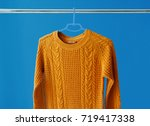 warm woolen sweater hanging on... | Shutterstock . vector #719417338