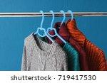 warm woolen sweaters hanging on ... | Shutterstock . vector #719417530