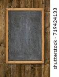 empty blackboard on rustic... | Shutterstock . vector #719424133