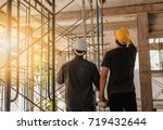 two engineers working in a... | Shutterstock . vector #719432644