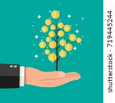 businessman hand with coin tree.... | Shutterstock .eps vector #719445244