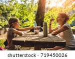 mother and daughter eating...   Shutterstock . vector #719450026