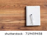 syringe  notepad with syringe... | Shutterstock . vector #719459458